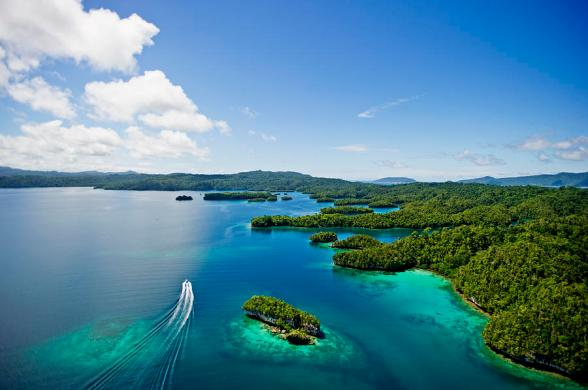 aerial-view-of-raja-ampat-islands-with-boat-wake-james-morgan