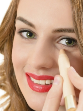 woman-applying-concealer-under-eyes.jpg